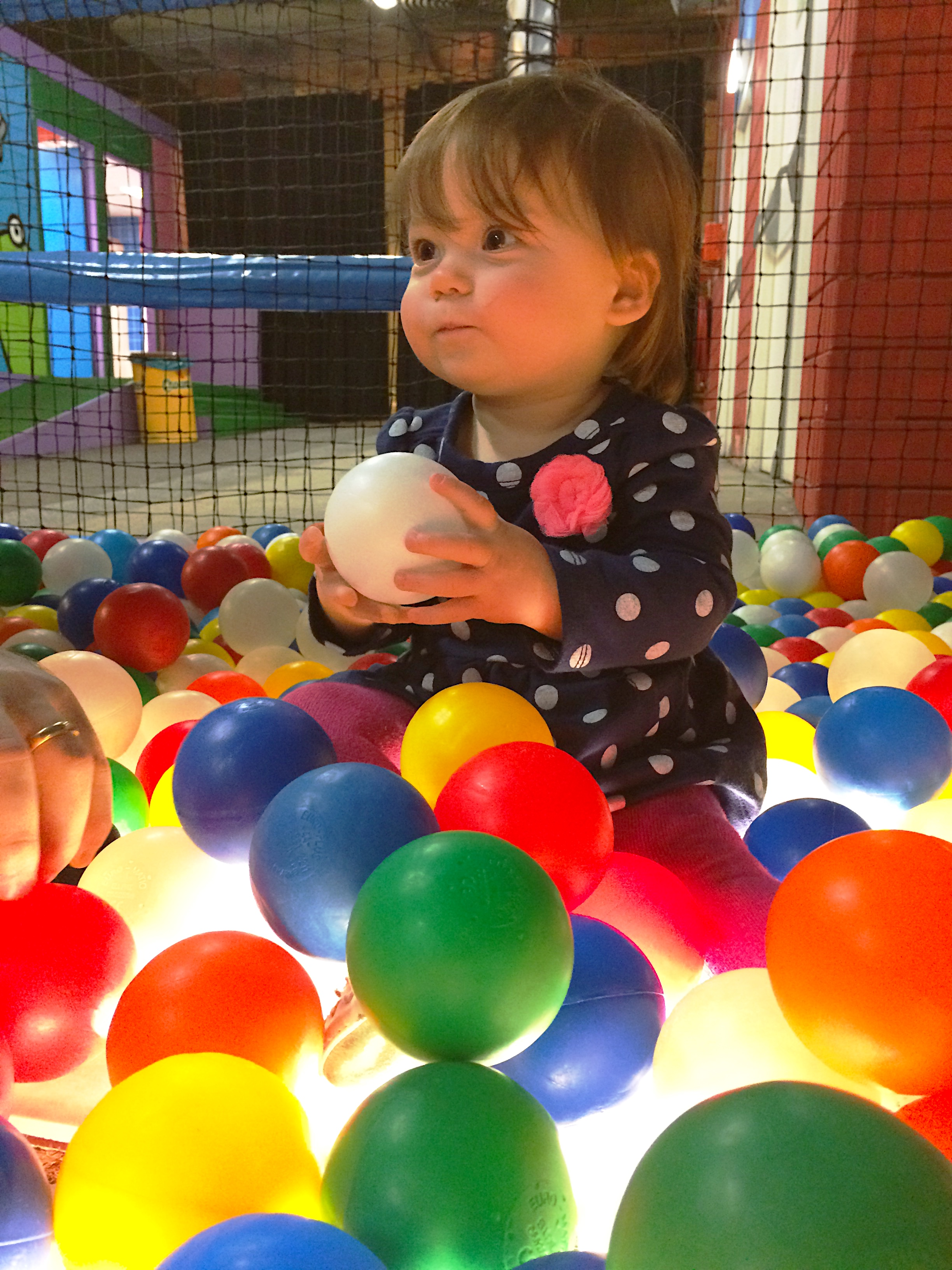 Ava in the ball pit